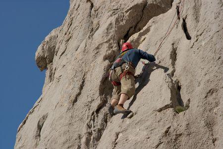 Rock climber on a grey rock wall Stock Photo - 905823