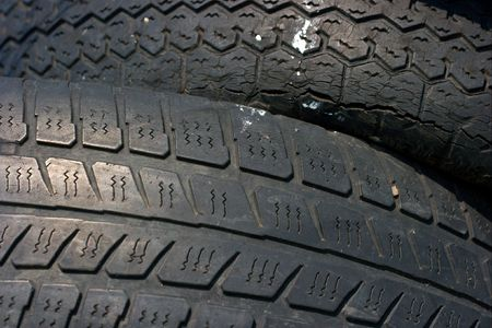 Detail of two used tyres photo