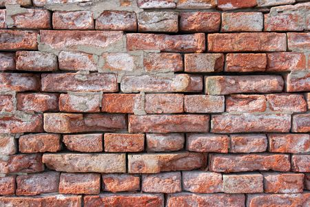 Wall of small reddish bricks photo