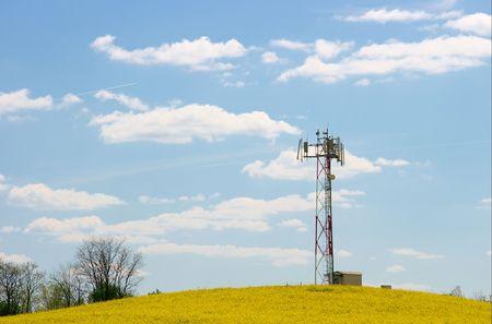 Gsm transmitter on a yellow rape field