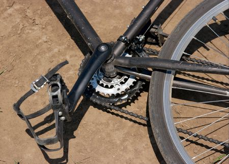Closeup of a bicycles gear on the ground  photo