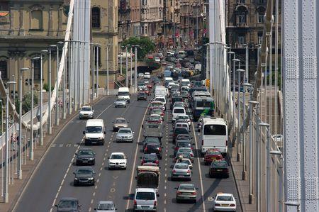 slow lane: Heavy traffic on a main road over a bridge