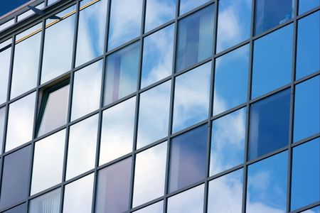 coporate: Detail of a modern office building with sky reflection Stock Photo