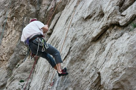 Rock climber coming down from the wall Stock Photo - 965981