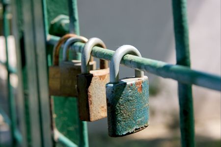 Many padlocks on a bar of a metal fence Stock Photo - 965997