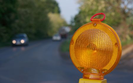 redirect: Yellow warning light at a road construction