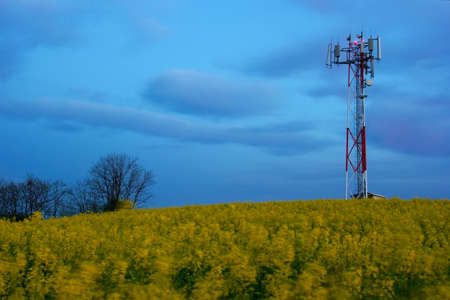 GSM transmitter station in the evening on a field