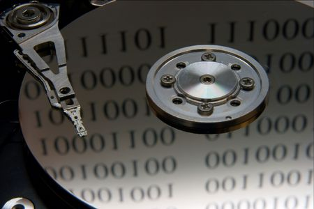 internals: Closeup of the internals of a harddisk with binary reflections