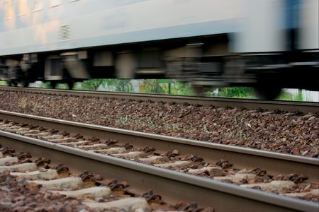 Passenger train on the track with motion blur photo