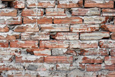 Simple brick wall with small bricks photo