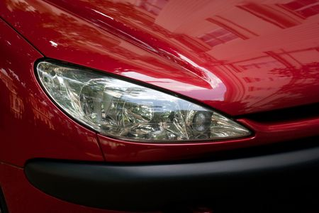 Closeup of the headlights of a red car Stock Photo - 1164454