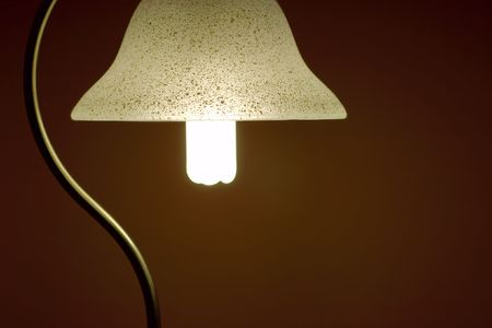 Soft light of a lamp in a dark room photo