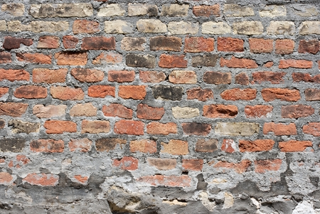 old brick wall with different colored bricks photo