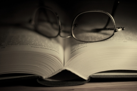 Open book with glasses in dark environment Stock Photo - 1479501