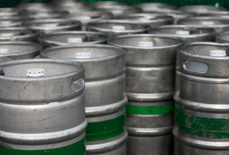 Lots of metal barrels at a beer factory Stock Photo