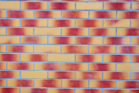 Brick wall with red-yellow gradient color bricks photo