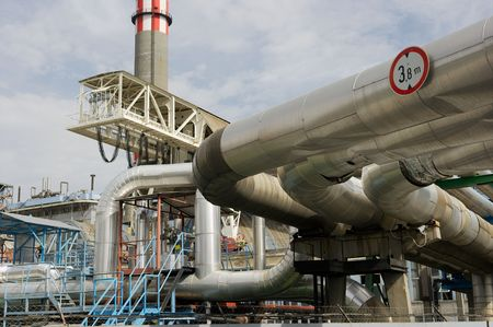 Pipes and tubes and chimney at a powerplant Stock Photo - 1778927