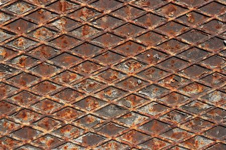 A piece of an old rusty iron structure