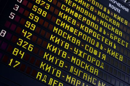 cyrillic: Schedule bord at a railway station with cyrillic letters