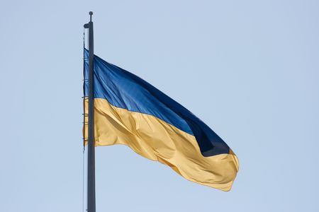 anthem: Ukrainian flag in the wind against clear blue sky