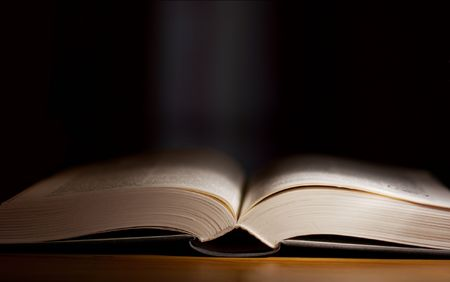 Thick open book in a dark room Stock Photo - 1826791