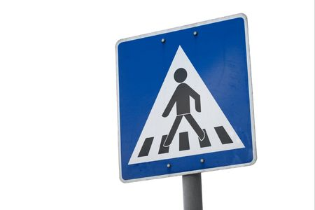 Pedestrian crossing traffic sign isolated on white photo