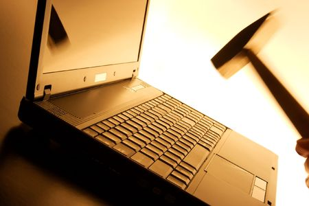 destruct: Laptop about to being hit by a hammer