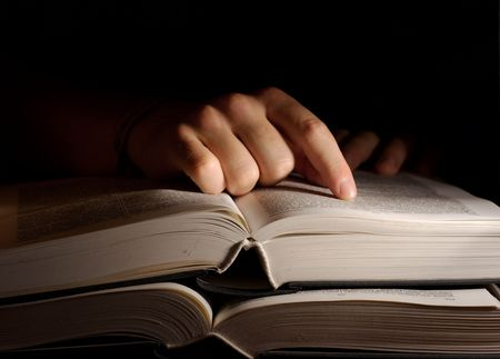Open book in the dark with a hand Stock Photo - 1884352