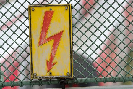 Electric shock warning sign on a fence photo