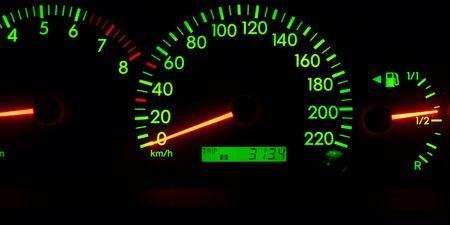 Dashboard of a car glowing green photo