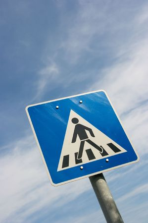 Pedestrian crossing traffic sign against cloudy blue sky Stock Photo - 2026242