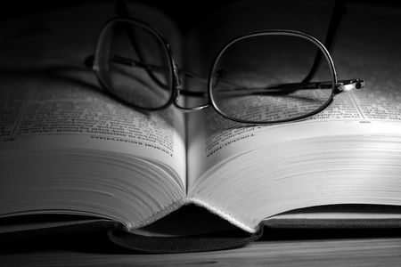 Open book in black and white with glasses on it Stock Photo - 2133418