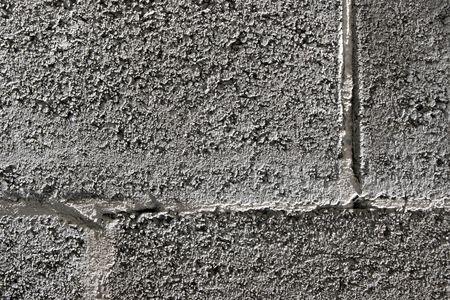 Mortar and bricks, rough wall texture closeup photo