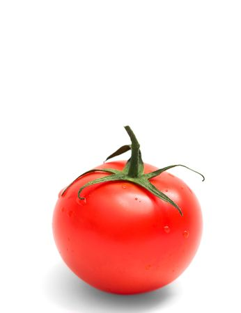 Perfect red tomato isolated on white background photo