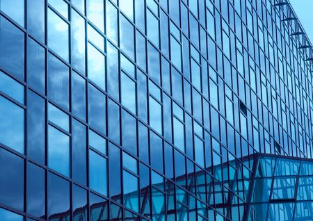 Huge modern office building with blue glass surfaces photo