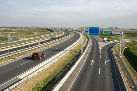 Banding highway with little traffic and exits photo