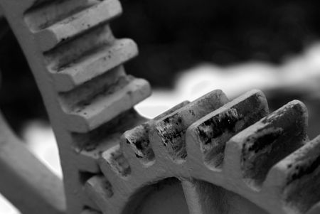 copysapce: Closeup of two cogwheels in black and white