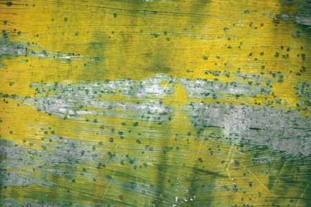 falling apart: Yellow and green texture of paintwork falling apart