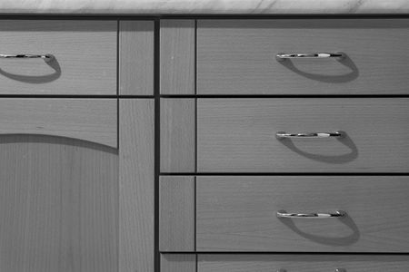 Simple lines of a kitchen cabinet photo
