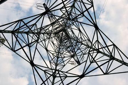 High voltage electric pillar metal framework from under Stock Photo - 2404150