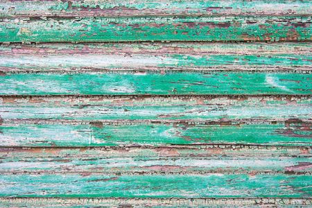 falling apart: Wood texture with green paintwork falling apart