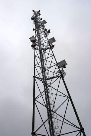 electromagnetic radiation: High transmitter tower against overcast sky