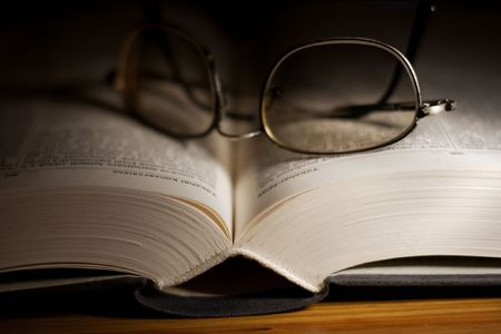 Open thick book with glasses Stock Photo - 2677940