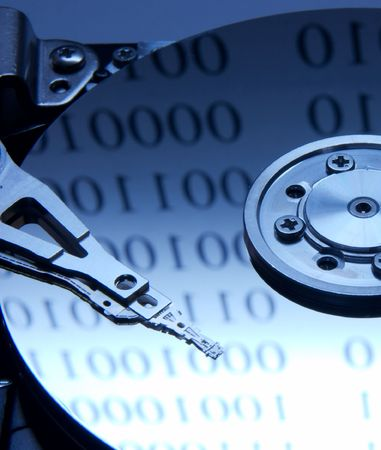 databank: Internals of harddisk with binary digit reflections Stock Photo