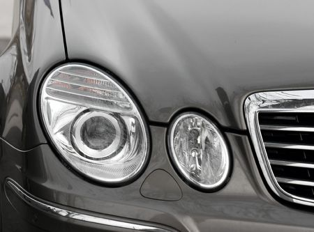 Round headlights of a car photo