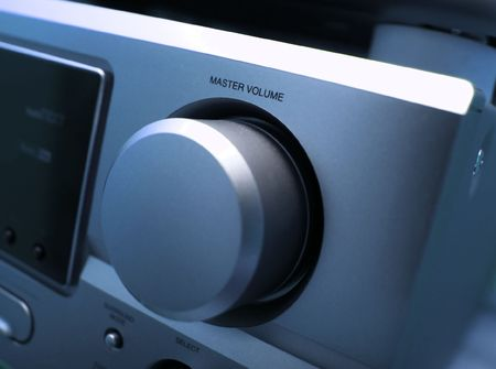 master volume: Detail of a hifi amplifier in blue tone Stock Photo