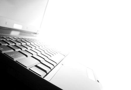 highkey: Highkey image of a black laptop Stock Photo