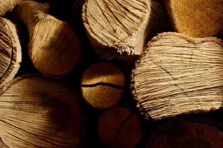 Pile of logs at night photo