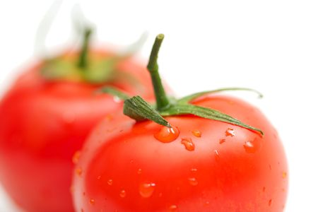 Two perfect red tomatoes on white background photo
