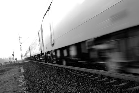 Fast passenger train motion blur. Highkey image photo